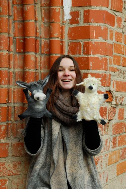 "felt toys on hand ""friends"" donkeys and sheep"