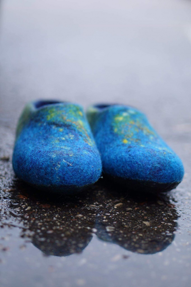Blue felted slippers of womens